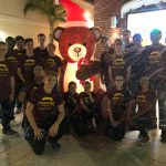 The Manatee High School Drum Line poses with a bear in a blizzard