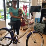 Holiday bike winner: poodle and friend