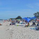 Island explodes with holiday revelers amid COVID-19
