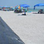 Beachgoers navigate pipeline to reach shoreline